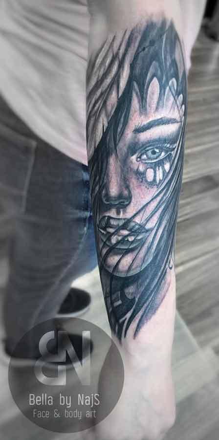 Woman Tears Tattoo