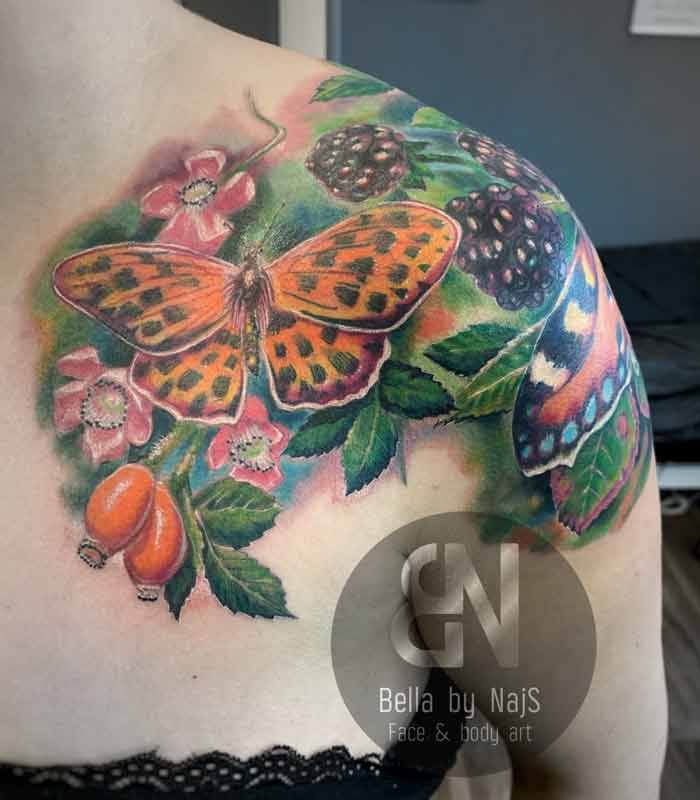 Butterfly in the garden tattoo